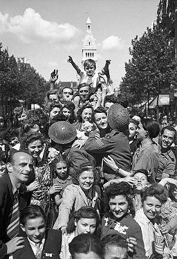 Cheering crowds greet British troops in Paris, 26 August 1944. BU21